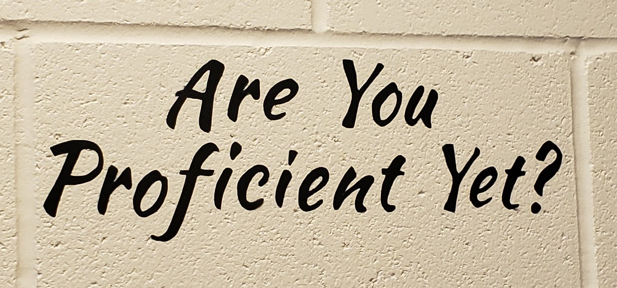 Sign on Wall That Says Are You Proficient Yet