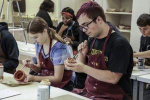 Students Glazing Ceramics