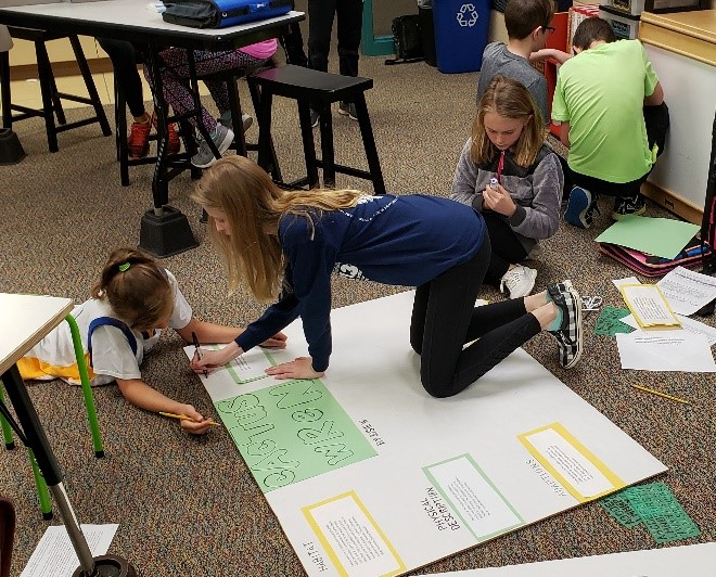 Harrisburg Students Working on Floor, Three Girls