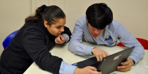 Student and Teacher at Laptop