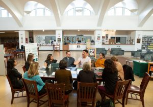 Educators at Conference Table in Library