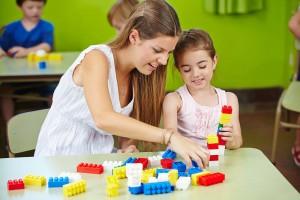 bigstock-Nursery-teacher-and-girl-playi-67565977--web