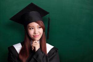A graduating student in cap and gown.