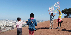 Four children with a kite